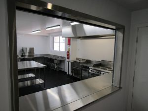 completed commercial kitchen through service hatch