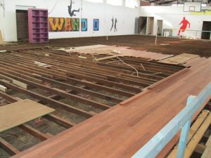 new floor boards being installed in sport court