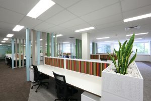 workstations with planters and feature screen walls