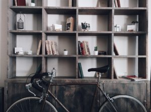 bike stored against bookcase in office